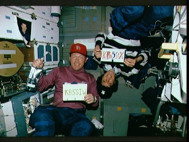 Crewmembers in the mid deck displaying their SAREX radio call signs.