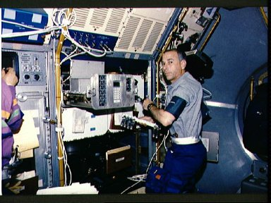 Crewmember in spacelab with the Generic Bioprocessing Apparatus, rack # 10.