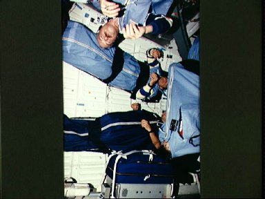 STS-51 astronauts photographed during sleep period on Discovery's middeck