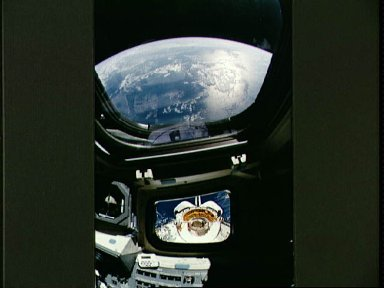 View of the Discovery's payload bay during EVA taken from inside shuttle