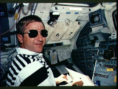 Astronaut Frank Culbertson takes notes about mission activity on flight deck