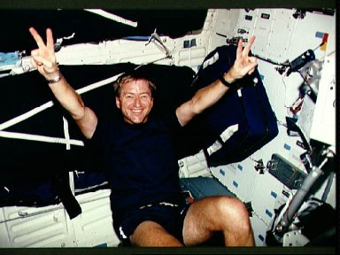 Astronaut Frank Culbertson on the ergometer in STS-51 Discovery's middeck