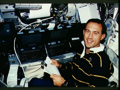 Astronaut James Newman works with computers and GPS
