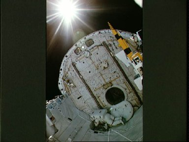 Astronaut Carl Walz during EVA in Discovery's payload bay