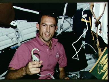 Astronaut James Newman with latch hook for tether device