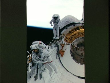 Astronauts Newman and Walz evaluate tools for use on HST servicing mission