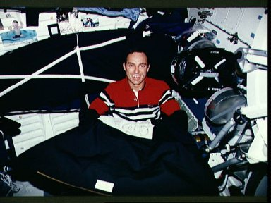 Astronaut Carl Walz changes out film magazine on the IMAX camera