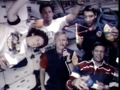 STS-54 crewmembers with DSO 802 and Physics of Toys on OV-105's middeck