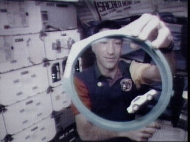 STS-54 MS1 Runco uses DSO 802 and Physics of Toys racetrack on OV-105's middeck