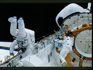 EVA Crewmembers working in the payload bay.