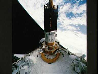 During STS-54 IUS/TDRS is released from cradle/tilt table above OV-105's PLB
