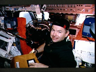 STS-56 Commander Cameron with camera stowage bag on OV-103's flight deck
