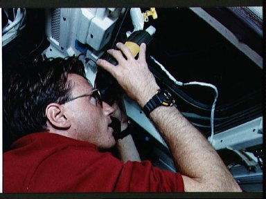 STS-56 MS1 Foale uses laser range finder on OV-103's aft flight deck