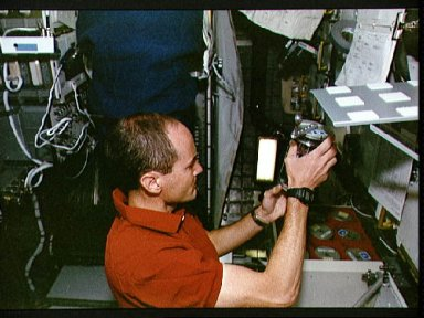 STS-57 MS and PLC G. David Low examines CGBA pack in OV-105's SPACEHAB module