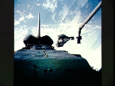 STS-57 astronauts Low and Wisoff, in EMUs, perform DTO 1210 EVA in OV-105's PLB