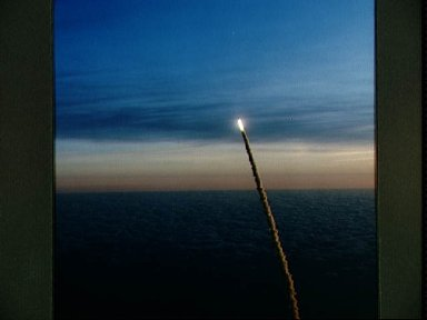 Launch of STS-60 Shuttle Discovery as seen from Shuttle Training Aircraft
