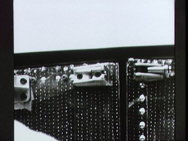 Latch of HST aft shroud photographed by Electronic Still Camera