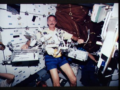 Astronaut Jeffrey Hoffman displays tools for use on HST