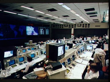 Flight controller Kevin McCluney monitors STS-61 astronauts during EVA