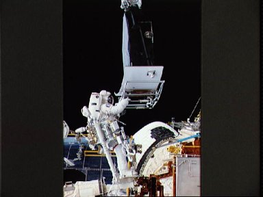 Astronaut Jeffrey Hoffman with Wide Field/Planetary Camera during EVA