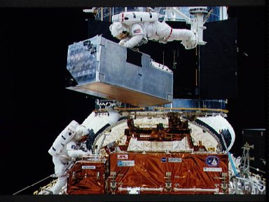Astronauts Thornton and Akers in payload bay during EVA to replace COSTAR