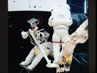 Astronauts Musgrave and Hoffman during first STS-61 EVA