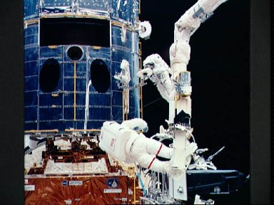 Astronauts Hoffman and Musgrave during EVA to repair Hubble Space Telescope