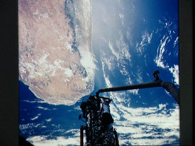 Astronauts Hoffman and Musgrave install the Magnetic Sensing System on HST