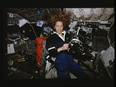 Astronaut Marsha S. Ivins prepares to use three Hasselblad cameras together