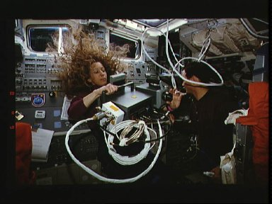 Astronaut Marsha S. Ivins with thermal imaging project on flight deck