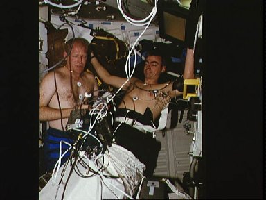 Astronauts Gemar and Allen work with lower body negative pressure experiment