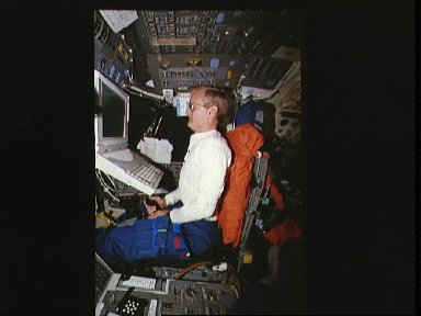 Astronaut John H. Casper uses Portable In-flight Landing Operations Trainer (PILOT)