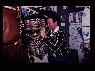 Astronaut Pierre J. Thuot works with Middeck O-Gravity Dynamics Experiment (MODE)