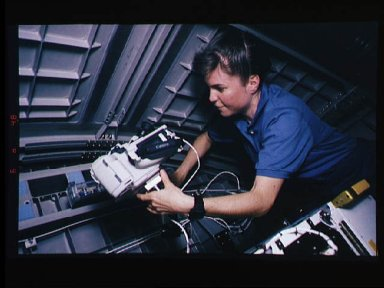 Astronaut Janice Voss with video camera in Spacehab-3