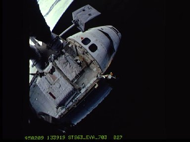 Discovery's foward section photographed during EVA
