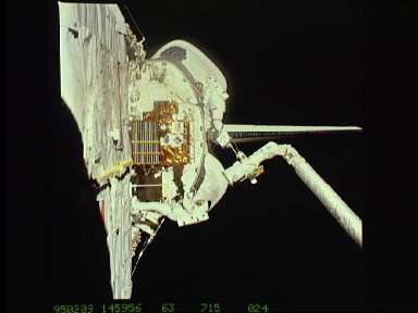 Astronaut Michael Foale on RMS arm during EVA