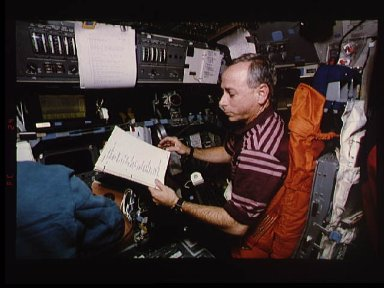 Astronaut Carl Meade mans pilots station during trajectory control exercise