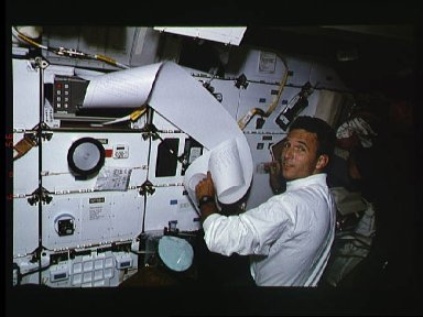 Astronaut Jerry Linenger with sheet of TIPS correspondence