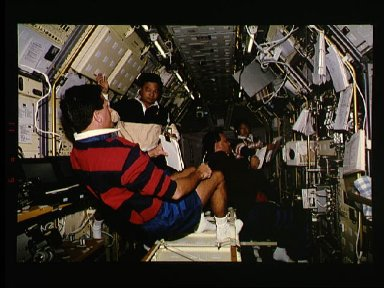 STS-65 crew works inside the IML-2 spacelab module aboard Columbia, OV-102