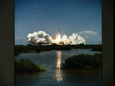 STS-65 Columbia, OV-102, rises above KSC LC Pad 39A during liftoff