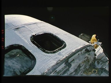 Astronaut Richard Richards looks out of Discovery's flight deck window