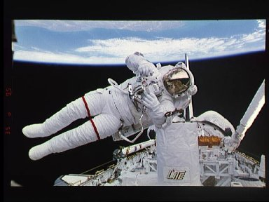 Astronaut Mark Lee floats free of tether during EVA