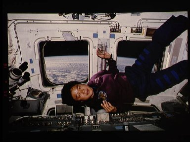 STS-65 Japanese Payload Specialist Mukai on OV-102's aft flight deck