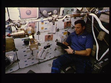 Astronaut Stephen Oswald monitors the MACE experiment