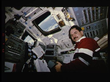 Payload specialist Ronald Parise checks on ASTRO-2 payload