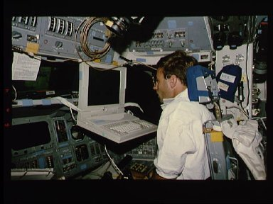 Astronaut William Gregory practices with PILOT laptop computer