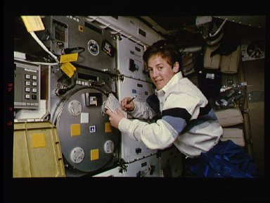 Astronaut Wendy Lawrence monitors the Protein Crystal Growth experiment