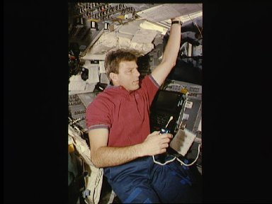 Astronaut Stephen Oswald during communcation with ground controllers