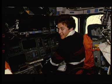 Astronaut Wendy Lawrence consults checklist during orbital operations