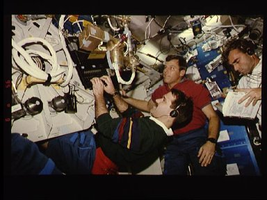 Astronaut Stephen Oswald and fellow crew members on middeck